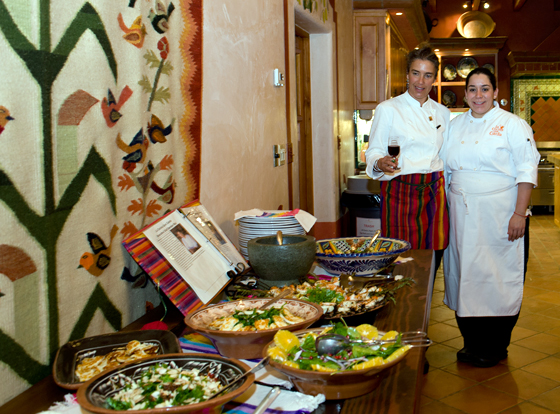 Romney Steele and cooking school chef Gabriela Lopez Alvarez survey the results of students work. Photo: Lynne Harty