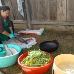 Family members prepare the fish in the backyard.