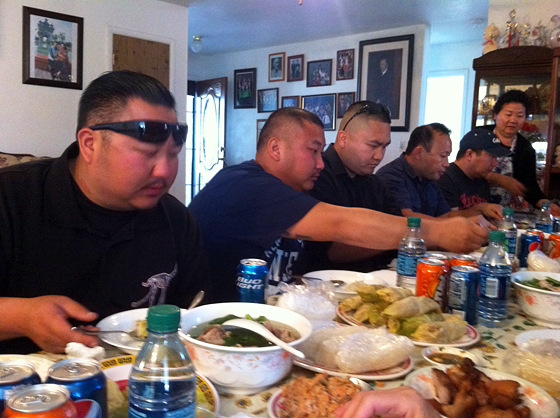 Men sit down to eat.