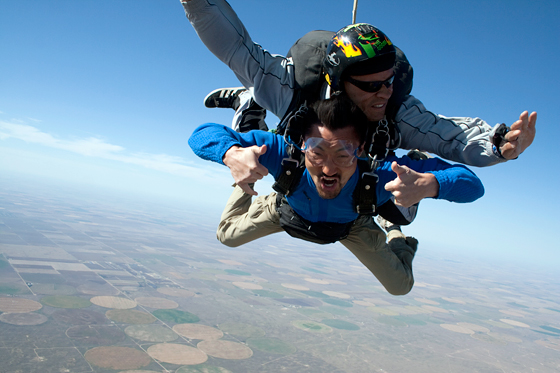 Host Yul Kwon skydiving in America Revealed. Photo: Courtesy of Lion Television