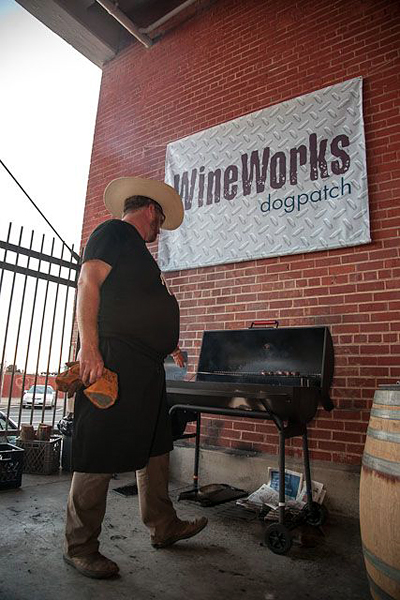 John Fink of The Whole Beast prepares his grill at Dogpatch Wine Works