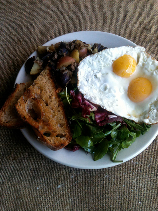 Fried eggs, toast and corned beef hash at Rogue Cafe