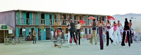 Stilt walkers approaching Black Rock French Quarter at Burning Man 2011. Photo: Kristen Lanum
