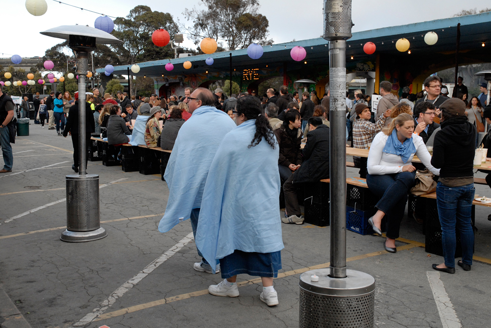 Night Market patrons wearing Snuggie-like attire. Photo: Wendy Goodfriend
