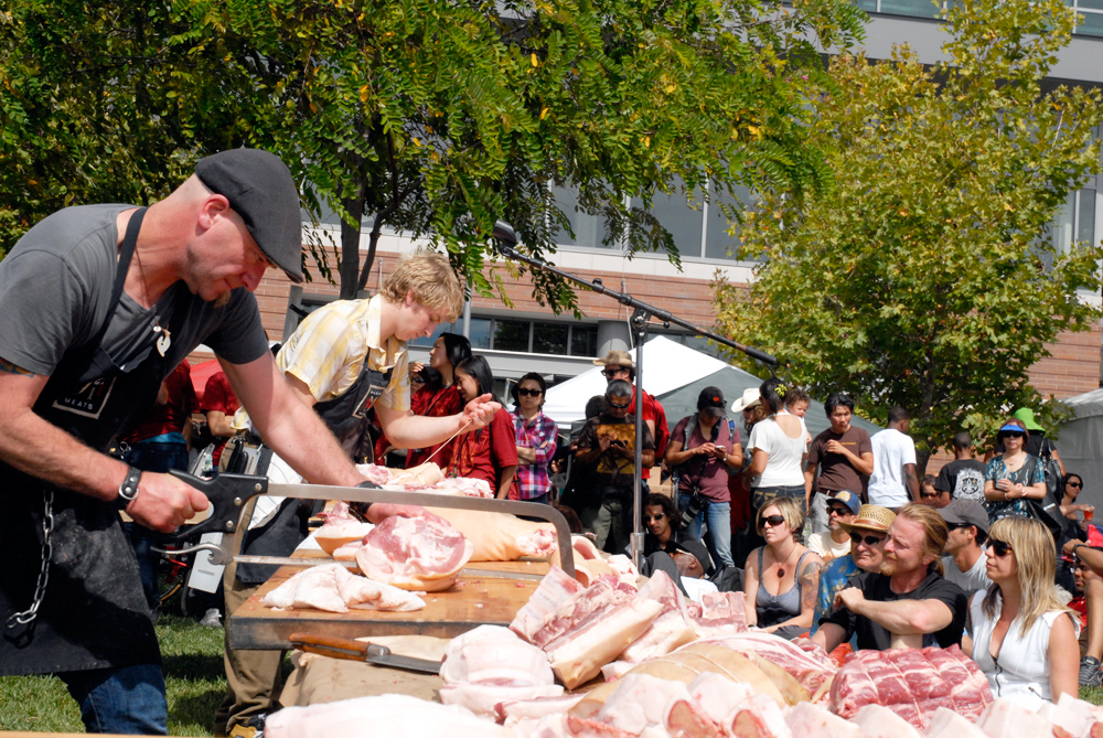 Dave the Butcher battles Daren King at 3rd Annual Flying Knives Pork Butchery Contest. Photo: Wendy Goodfriend