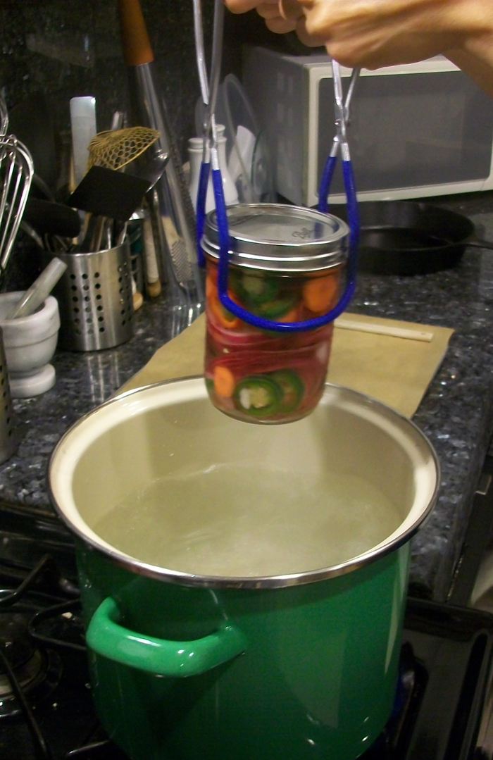 Boiling the jars helps to create a tight seal and kill any lurking bacteria. Photo: Joseph Wrye