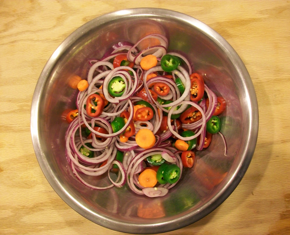 Red and green jalapenos, red onion and carrot are ready to be jarred and pickled. Photo: Joseph Wrye