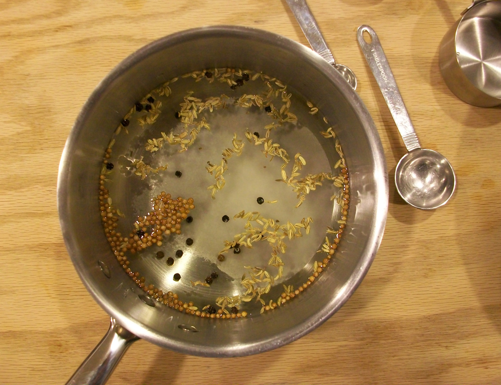Hot brine includes white wine vinegar, salt, sugar and aromatics. Photo: Joseph Wrye