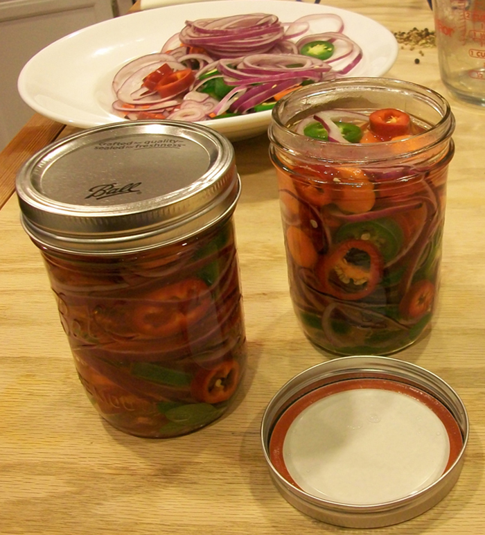 Pack vegetables snugly into jars. Photo: Joseph Wrye