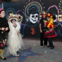 Day of the Dead participants in front of Dia de los Muertos mural in the Mission. Photo: Naomi Fiss