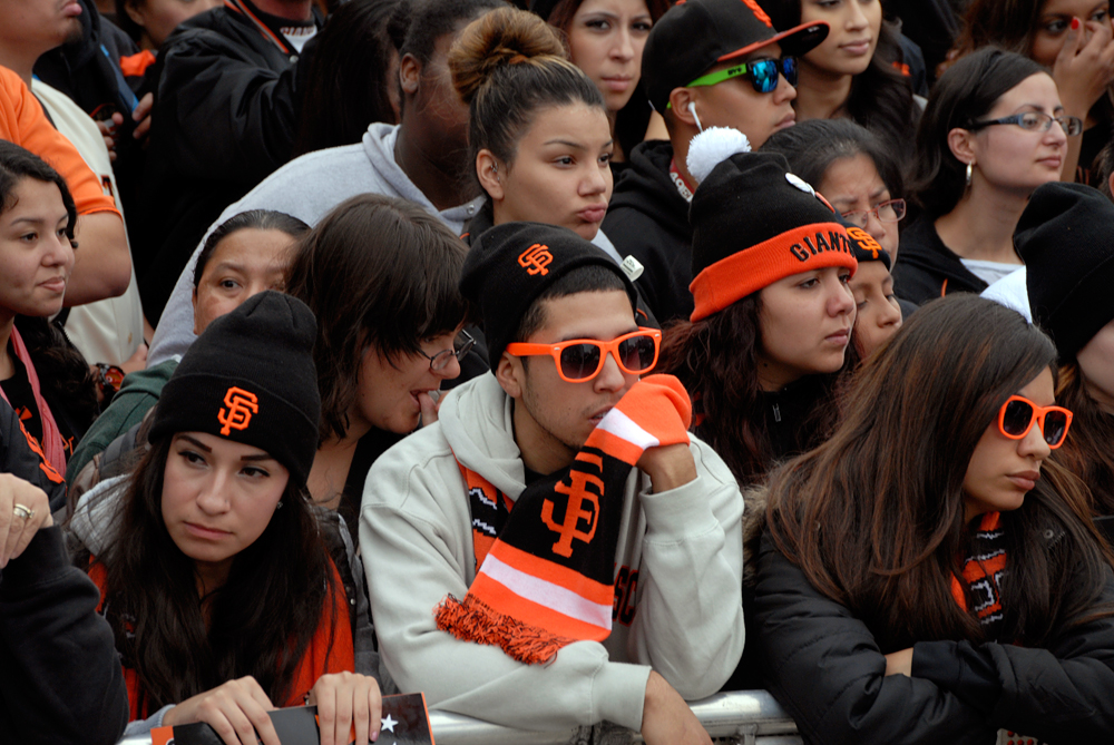 SF Giants fans sporting orange sunglasses. Photo: Wendy Goodfriend