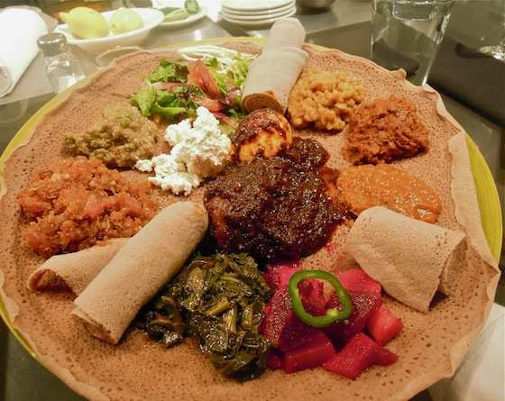 Platter of Ethiopian dishes served on injera