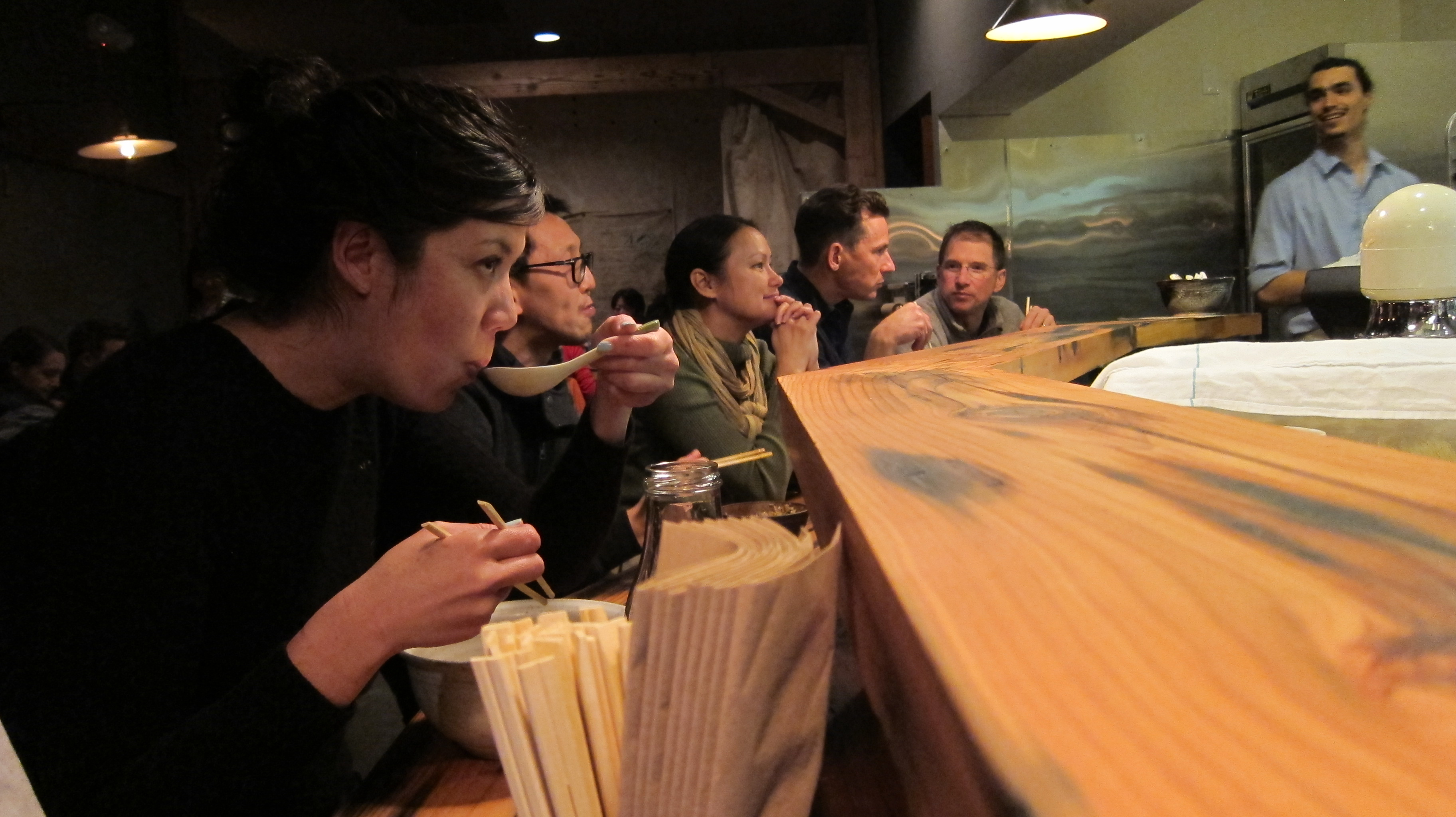 A customer samples ramen