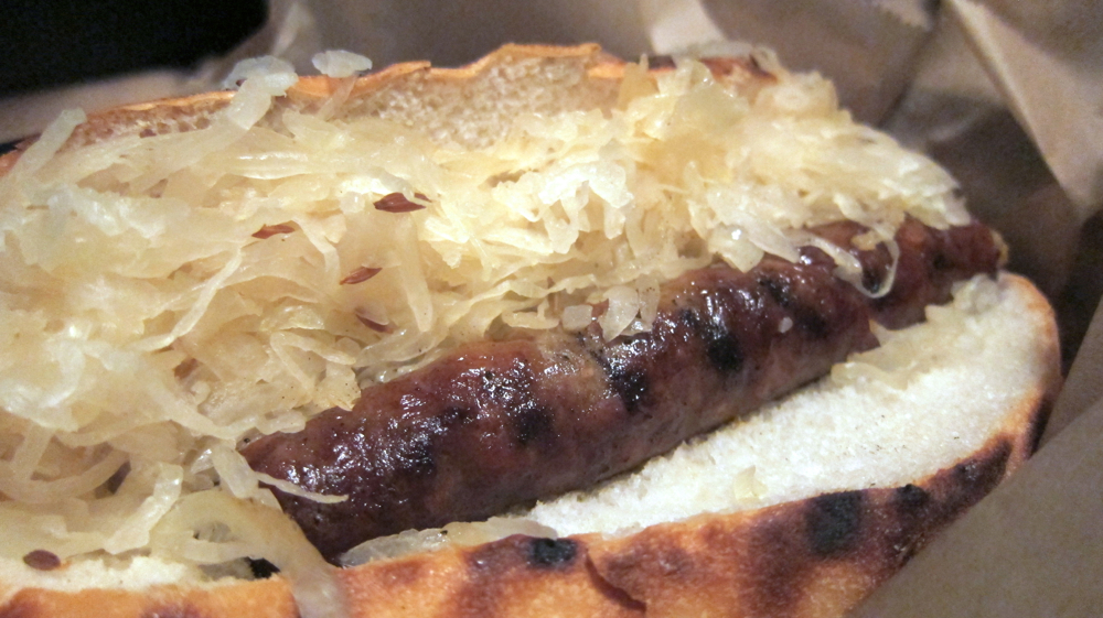 Merguez sausage with sauerkraut and sweet peppers
