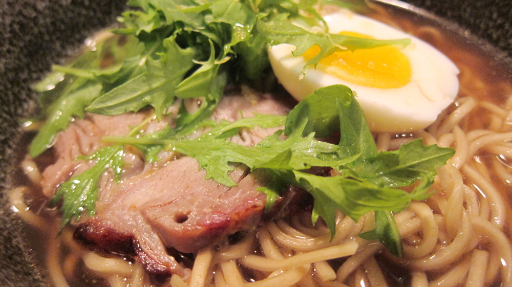 Meyer lemon ramen with salt-cured egg, spit-roasted chashu and mizuna