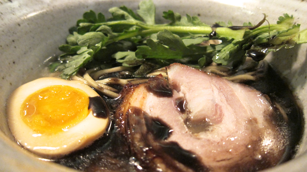 Tonkotsu ramen with soy-marinated egg, spit-roasted chashu, shungiku and black garlic oil