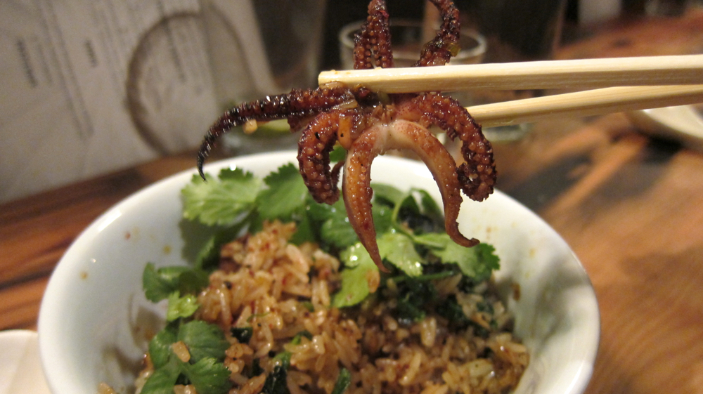 Wild nettle fried rice with Monterey Bay squid and chili paste