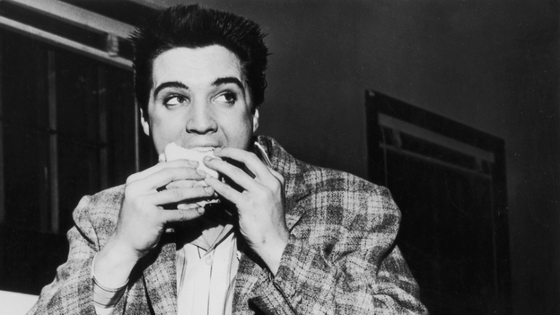 A still-trim Elvis Presley enjoys a sandwich in 1958. His love of fatty foods hadn't caught up to him yet. Photo: Hulton Archive/Getty Images
