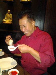 Martin Yan eating steamed dumplings at M.Y. China. Photo: Mary Ladd
