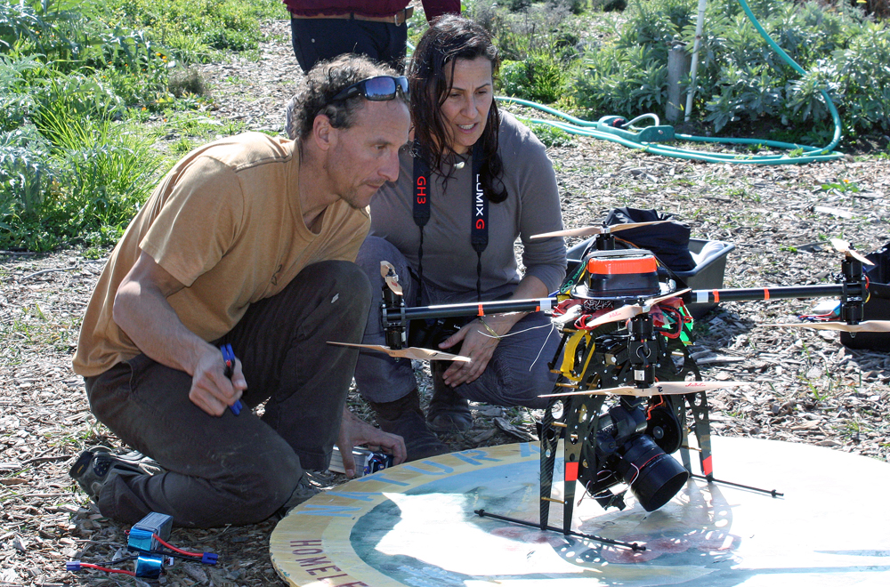 Andrea Blum with her brother Kenny, who built the remote-controlled helicopter used for the aerial photo.
