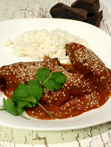 Here, Chocolate Mole is served over grilled chicken. But it's also commonly paired with pork. Photo: Peter Ogburn for NPR