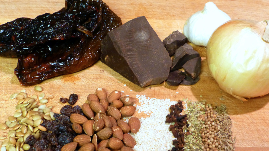 Mole is a complex sauce that marries chocolate with chilies, onion, garlic, spices, nuts and seeds and dried fruits. But it's just one of many ways to break chocolate out of the candy box. Photo: Peter Ogburn for NPR