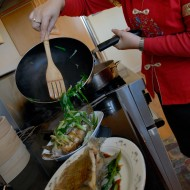 Lisa Li cooks scallions for whole fish. Photo: Wendy Goodfriend
