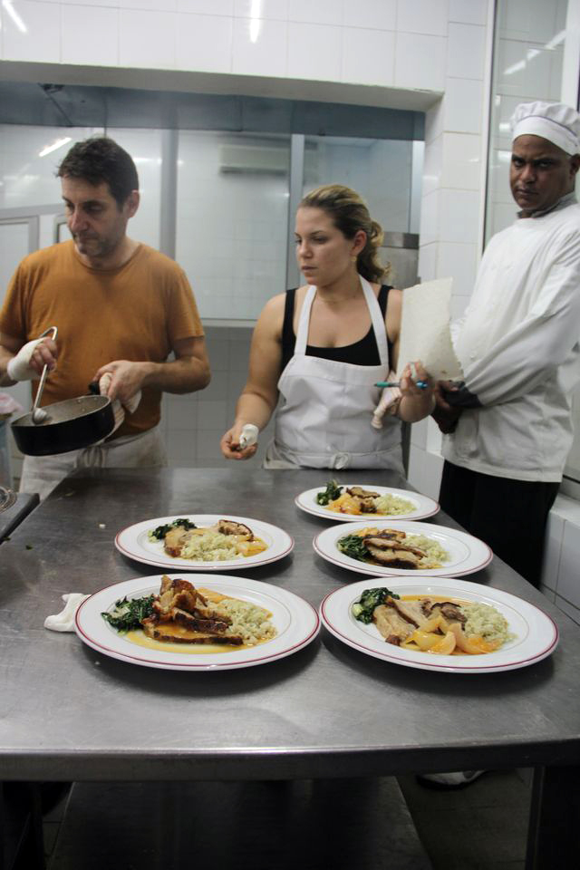 Danielle Alvarez gives plates a final look before sending them out to Cuban diners. Photo: Nina Wolpow