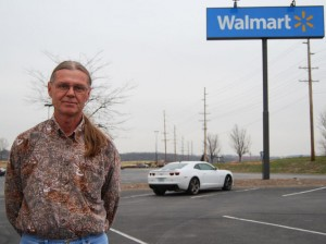 Produce broker Herman Farris, outside a Wal-Mart in Columbia, Mo., was heading to St. Louis to pick up a shipment of bananas for Wal-Mart.