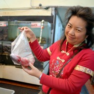 Lisa Li holding sea bass. Photo: Wendy Goodfriend