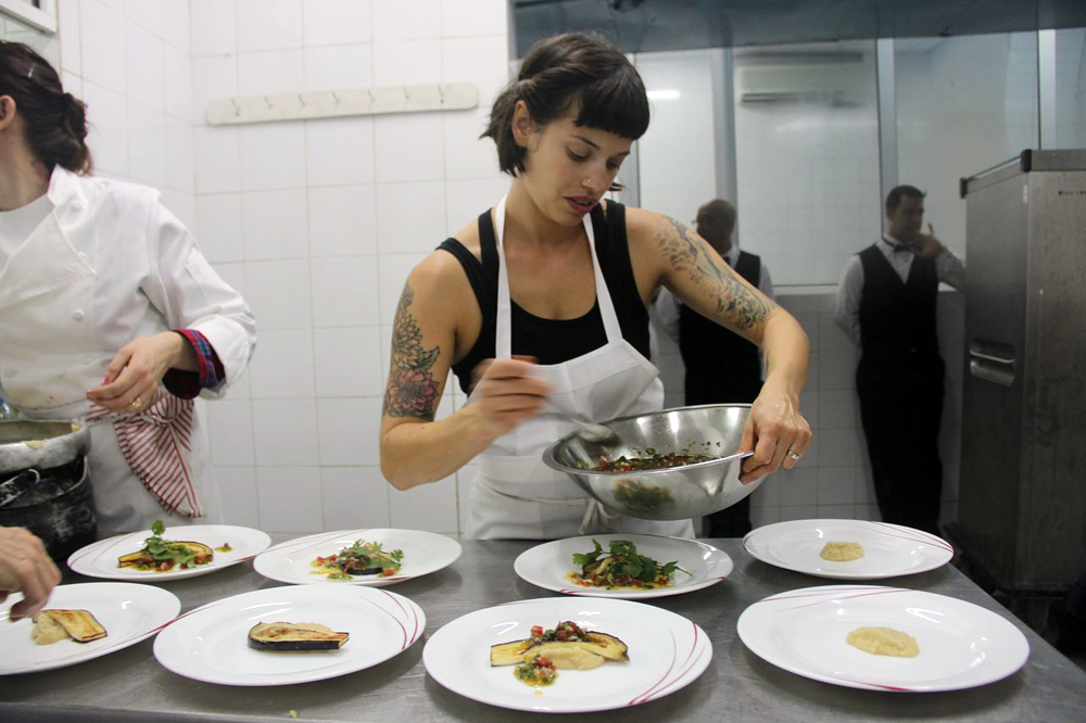 Fellow Cuban-American Melissa Fernandez plates dishes before serving Cuban dignitaries. Photo: Nina Wolpow