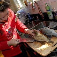 Lisa Li slices whole fish. Photo: Wendy Goodfriend
