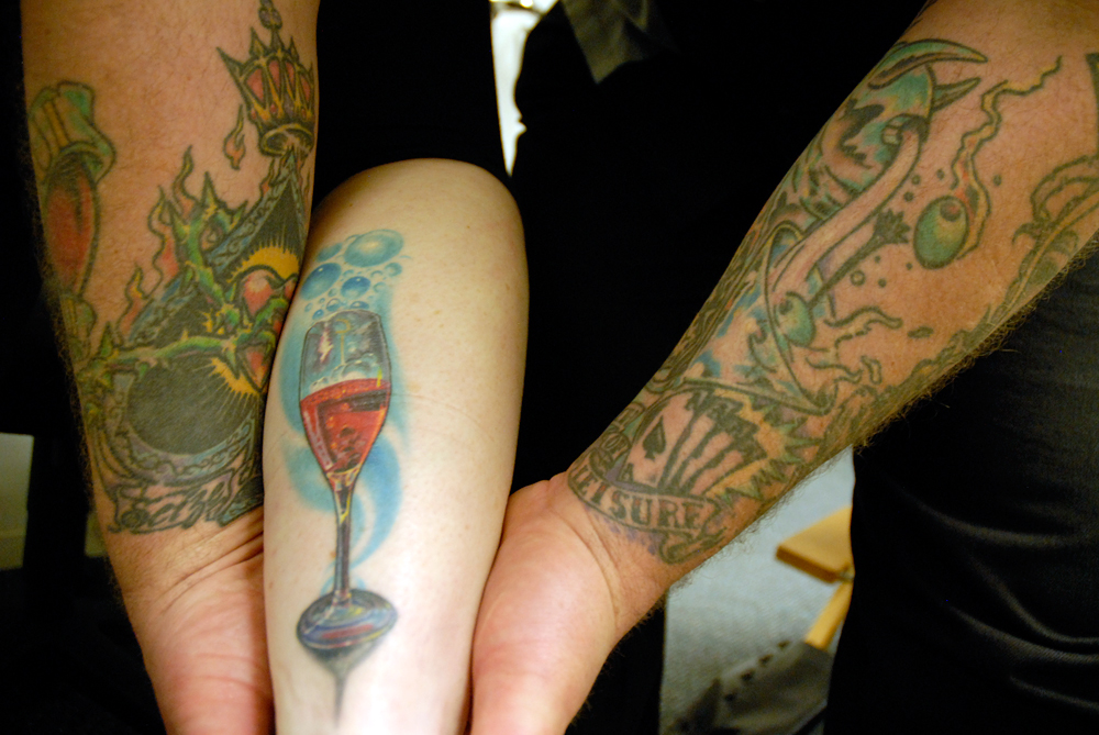 Leslie Sbrocco's wine glass leg tattoo (center). Photo: Wendy Goodfriend