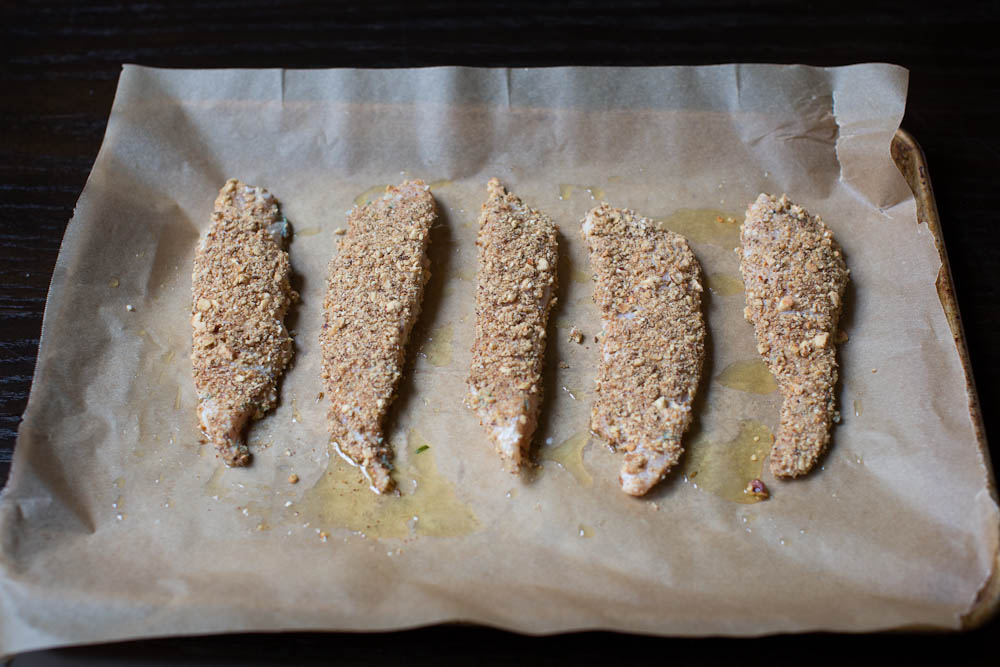 Dukkah Crusted Chicken Tenders ready for the oven
