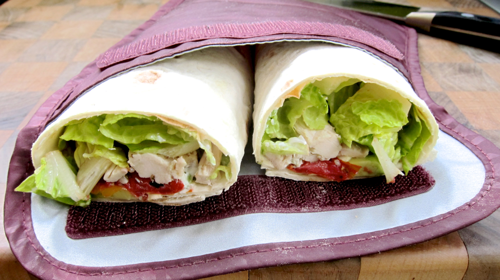 Lavash wrap with roasted chicken, avocado, roasted tomatoes, romaine lettuce and labneh.