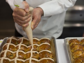 Chef Thomas Keller demonstrates how to apply homemade icing to his hot cross buns. Photo: Doriane Raiman for NPR