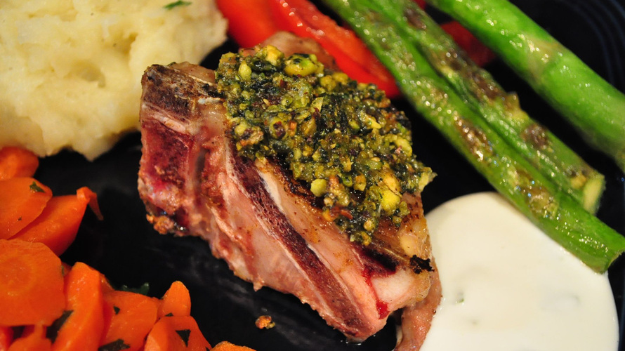 A lamb chop crusted with pistachio, mint and spices, served with assorted vegetables. Photo: Whitney Pipkin for NPR