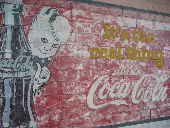 A Coca-Cola mural in Vicksburg, Miss., where the soda was first bottled in 1894. Mississippi's governor is expected to sign a bill that would prevent the regulation of soda portion sizes by counties or towns. Photo: pratt/via Flickr
