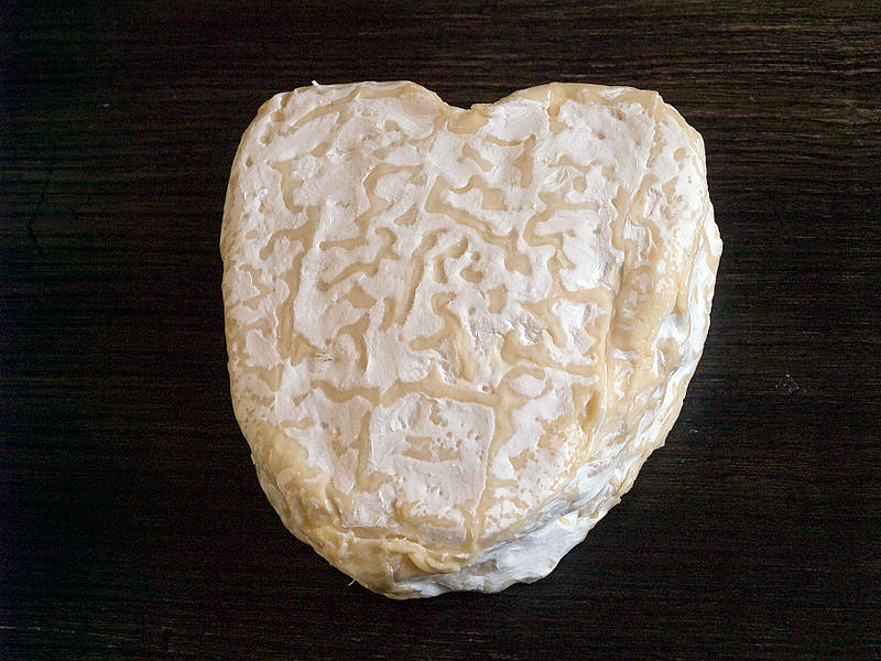 French Neufchâtel is a cheese made in the region of Normandy and usually sold in heart shapes. Photo: Myrabella
