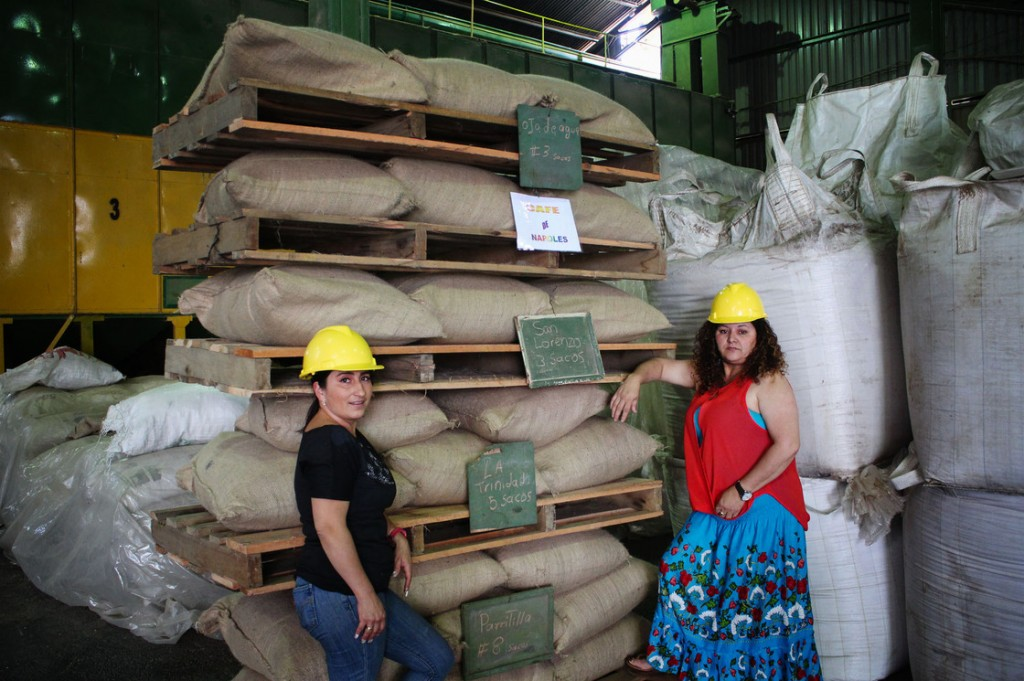 Angelina Zuñiga Godinez and Fanny Cordero Mora grow coffee for Coopetarrazu, one of Costa Rica's largest coffee cooperatives. These bags of coffee are labeled with the towns where they are grow. Photo: Dan Charles/NPR