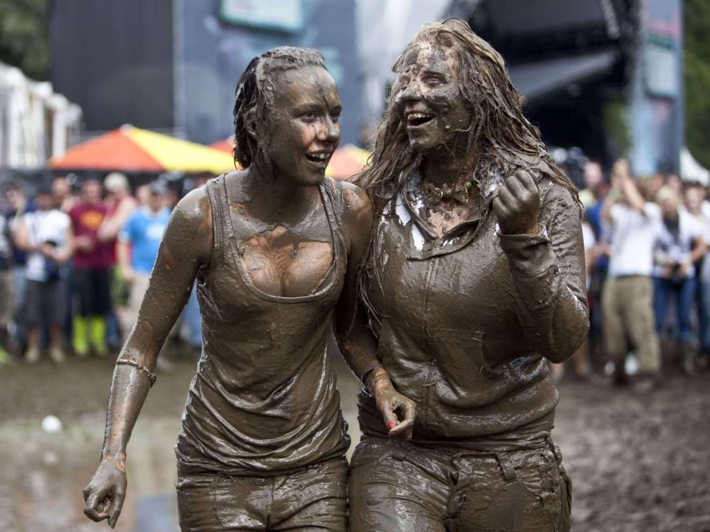 Looks like these two attendees at the 2009 Music Openair Festival St. Gallen in Switzerland couldn't resist jumping in the mud, either. Photo: Ennio Leanza/AP