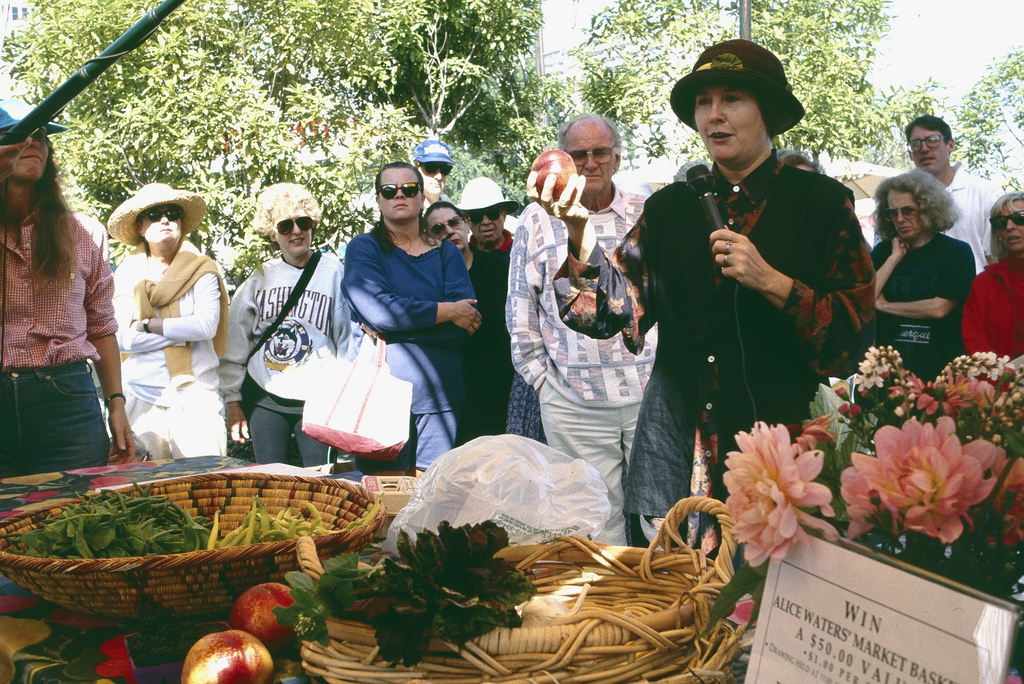 Archival photo of Alice Waters at the Ferry Plaza Farmers Market. Photo courtesy of CUESA