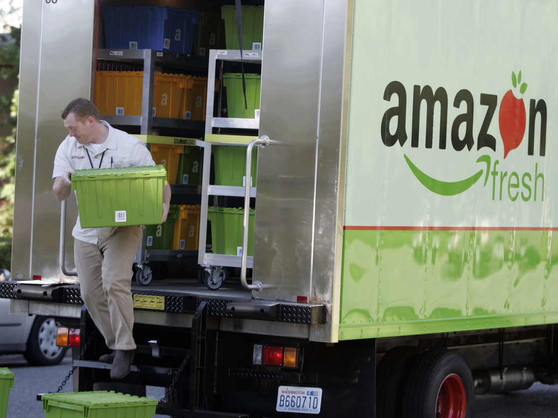 Amazon Fresh delivery man Tim Wilkie totes food to a house on Mercer Island, Wash. Photo: Joe Nicholson/AP