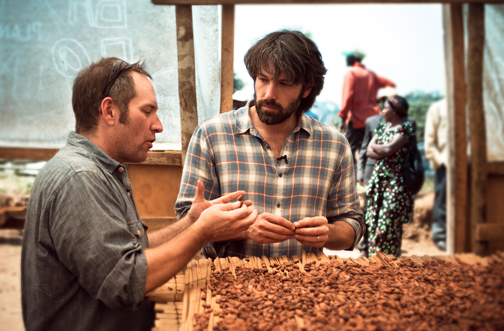 Theo Chocolate CEO Joe Whinney and actor and Academy Award-winning movie director Ben Affleck inspect cocoa beans in eastern Congo. Photo: Piet Suess