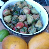 green strawberries, mangos, lime
