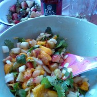 mixing green strawberry and mango salsa