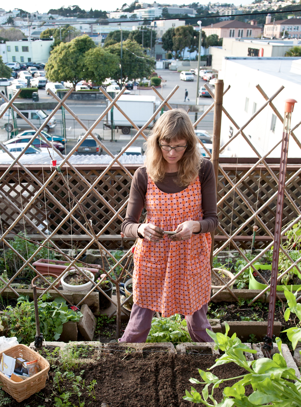 Heidi Kooy tends to produce and livestock in her Excelsior district backyard farm in San Francisco. Photo: Lori Eanes