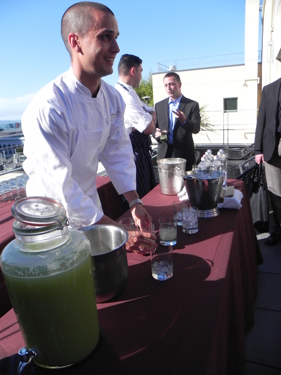 Stewart serving refreshing glasses of cucumber gin sours on a beautiful San Francisco evening.