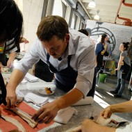 Chef Neil Davidson helps students butchering whole black cod. Photo: Wendy Goodfriend