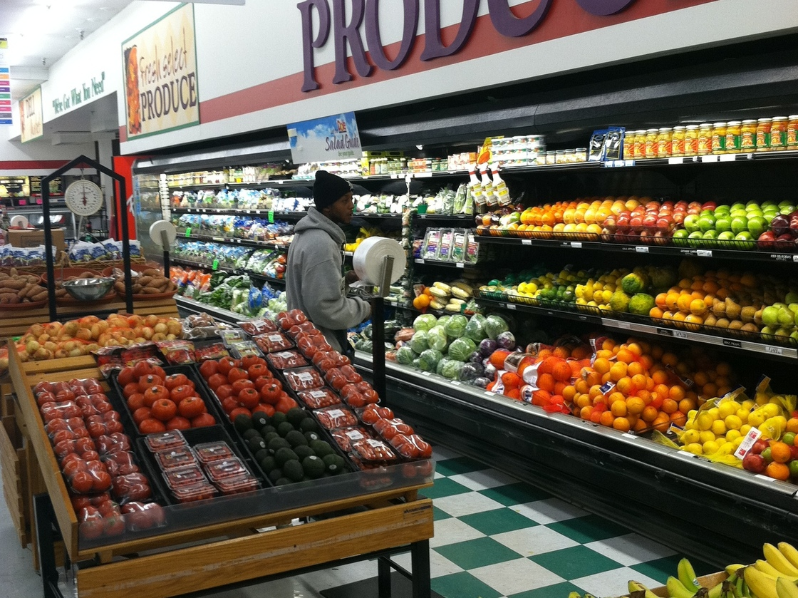 A customer in the produce section at Metro Foodland, one of the Detroit grocery stores participating in a healthy food incentive program for people with SNAP benefits. The store will add a section of specially marked local produce as part of the program. Photo: Courtesy of the Fair Food Network